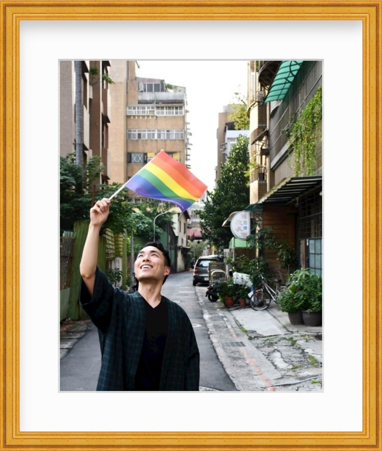 Man Waving Pride Flag in Taiwan in a gold frame