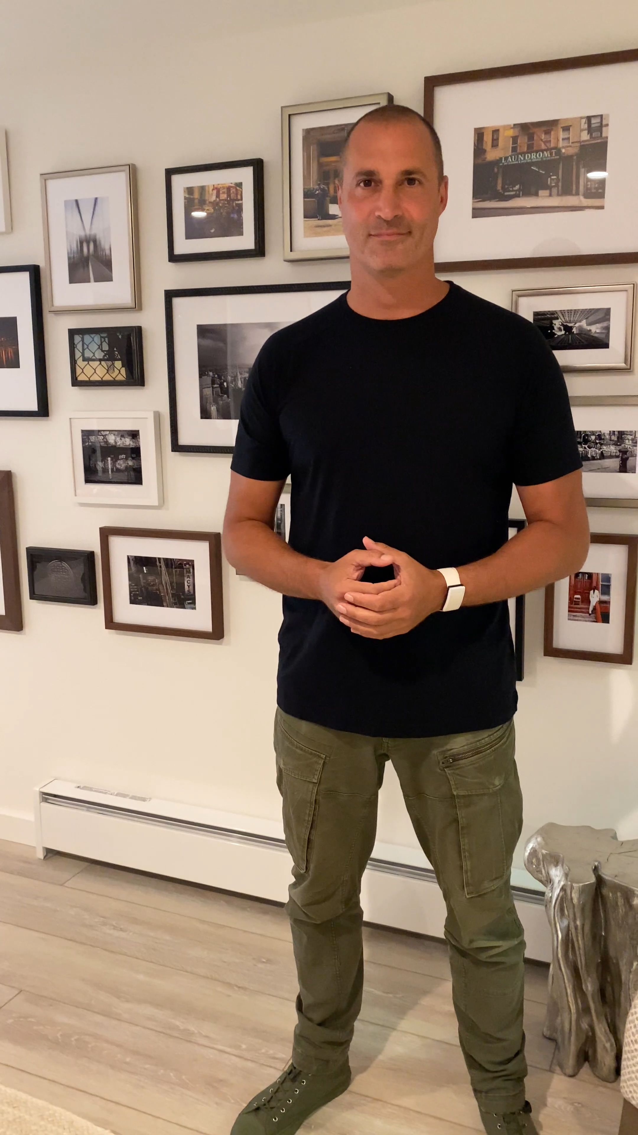 Nigel Barker in front of gallery wall