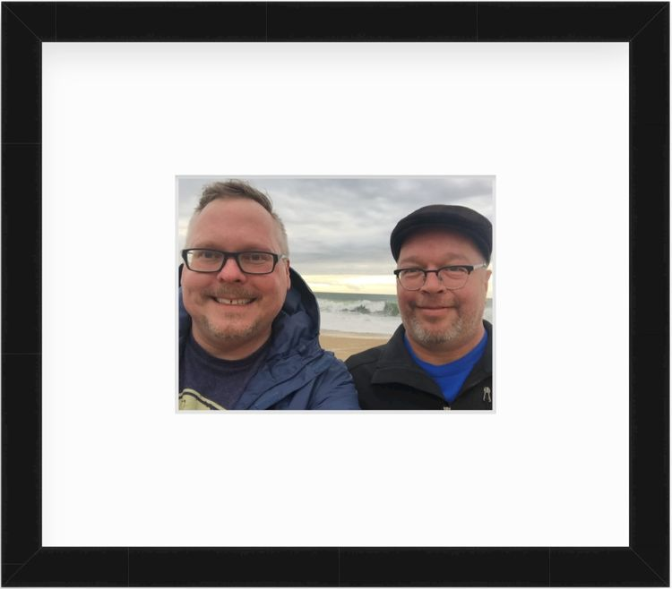 Couple at the beach in a black frame