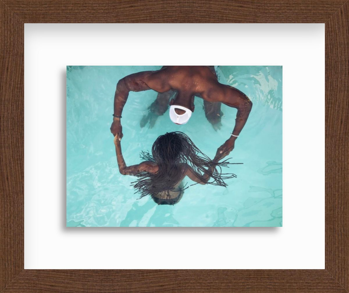 Man and woman in pool in frame