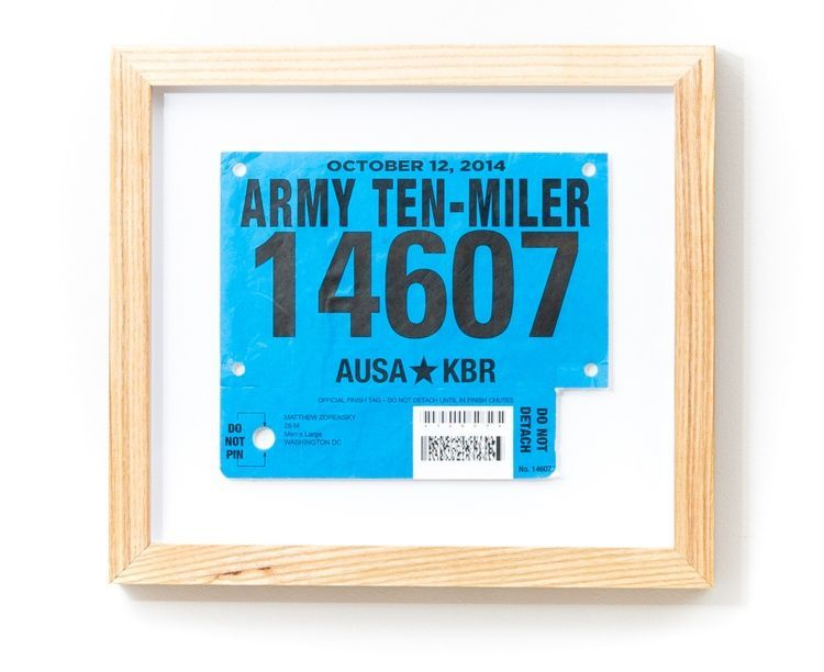 Army Ten-Miler race bib framed in a light wood frame