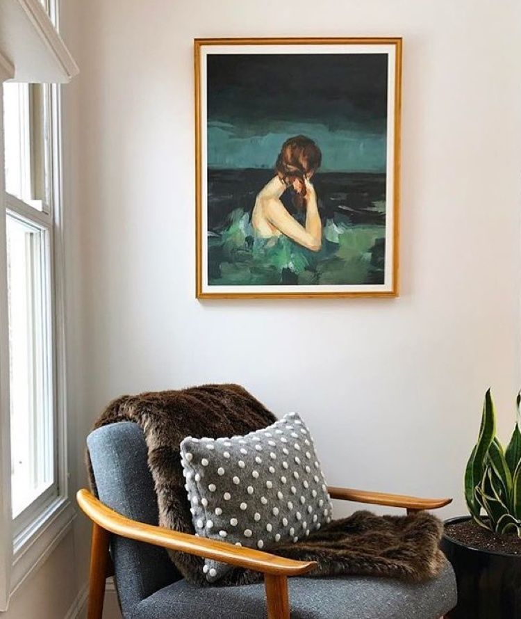 Clare Elsaesser painting of woman in green water framed in classic gold frame