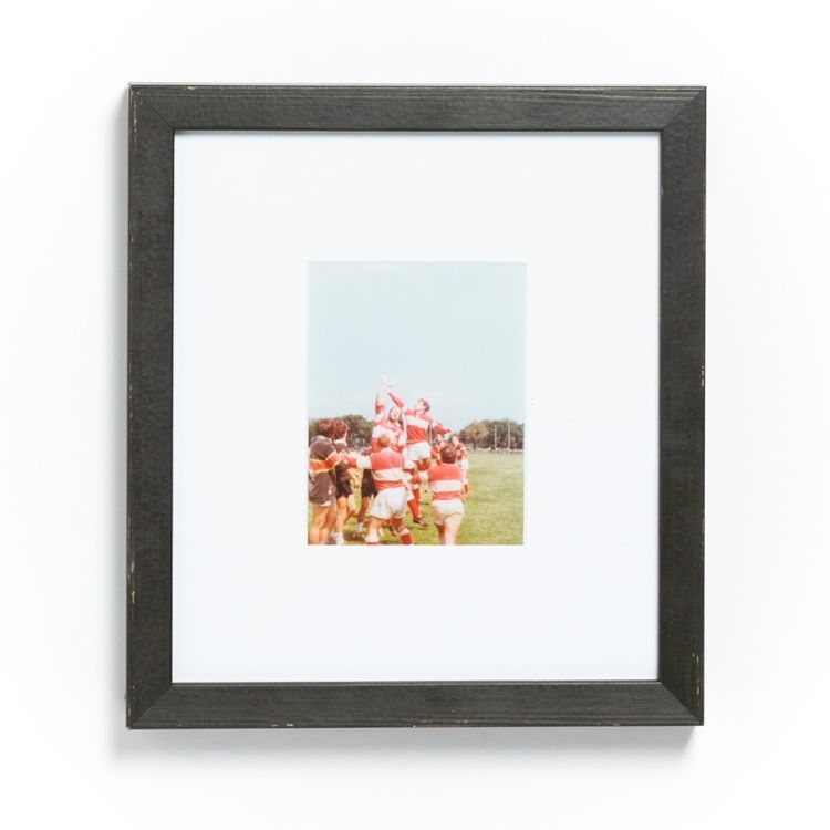 Vintage rugby photo in distressed black frame
